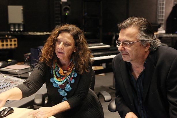 Professors Eve Edelstein and Peter Otto work on noise reduction technology in a lab at Calit2.