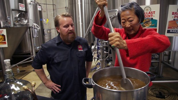 Chef Su-Mei Yu (right) learns how to brew beer from Colby Chandler of Ballast...