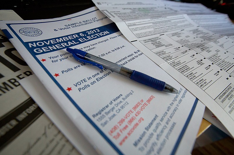 A voter completes a mail-in-ballot for the November 6, 2012 general election.