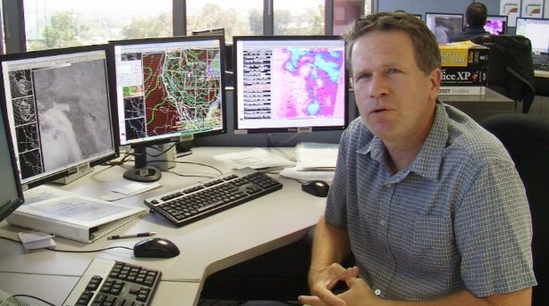 Alex Tardy, warning coordination meteorologist with the National Weather Service San Diego, explains how he monitors weather systems in San Diego at his Rancho Bernardo office, Oct. 2, 2013.