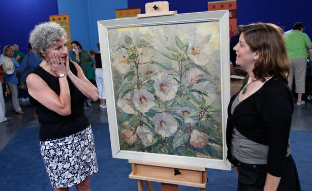 In Atlanta, Georgia, appraiser Robin Starr (right), shocks the owner of an heirloom circa 1930 painting by influential Philadelphia impressionist Mary Elizabeth Price, with an unexpected estimated value of $40,000-$60,000.