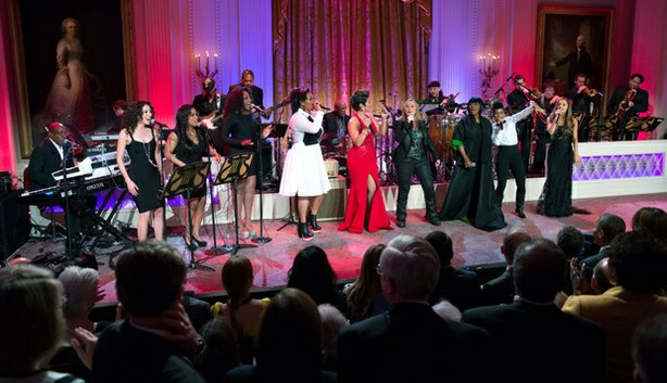 "Jill Scott, Tessanne Chin, Melissa Etheridge, Patti LaBelle, Janelle Monáe and Ariana Grande perform together on stage. President Barack Obama and First Lady Michelle Obama host ""Women Of Soul: In Performance At The White House"" in the East Room of the White House, March 6, 2014."