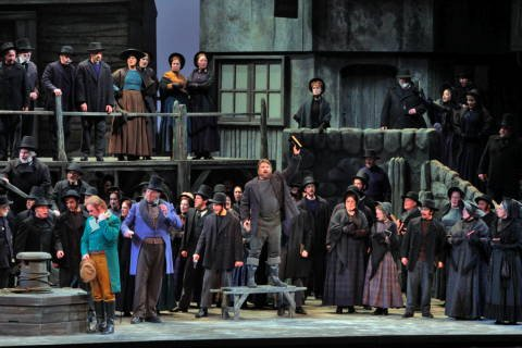 Greg Fedderly as Bob Boles (centre) with the San Diego Opera chorus in 'Peter Grimes'. Photo © 2009 Ken Howard