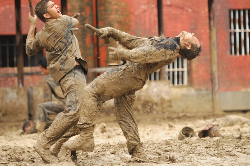 A muddy prison battle in