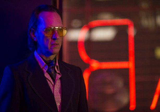 "Richard E. Grant as Dickie Black in ""Dom Hemingway."""