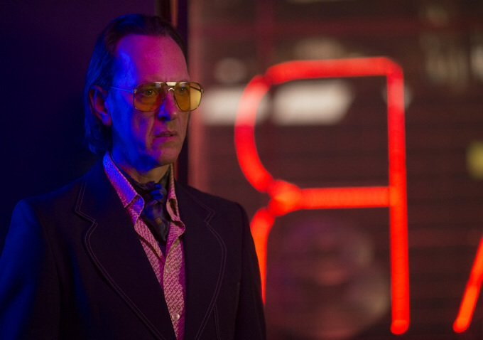 Richard E. Grant as Dickie Black in
