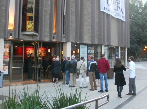 Patrons wait in line for the opera at the Civic Theatre downtown.