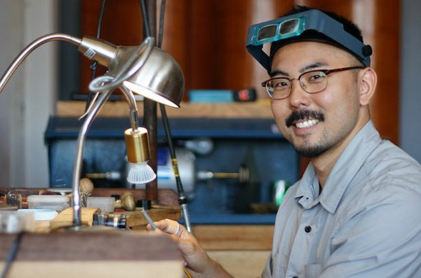 Artist Shane Yamane, shown working at his bench, combines traditional techniq...
