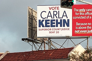 Judicial Candidate Accuses Judge Of Being A Criminal On Billboards