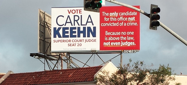 Federal prosecutor Carla Keehn, hoping to unseat Judge Lisa Schall in the June primary election, put four billboards around San Diego accusing her opponent of being a criminal, May 8, 2014.