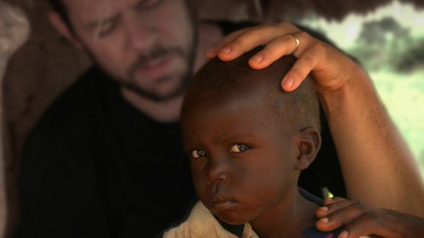 "Still from ""God Loves Uganda."" Journey to the heart of East Africa, where Ugandan pastors and their American counterparts spread God's word and evangelical values to millions desperate for a better life. Inspired by his own African-American Baptist roots, director Roger Ross Williams explores a place where religion and African culture intersect."