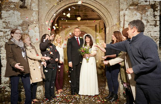 Wedded bliss. Doc and Louisa are married and the villagers throw confetti in ...
