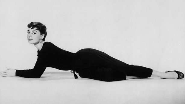 Full-length promotional portrait of Belgian-born actor Audrey Hepburn reclini...