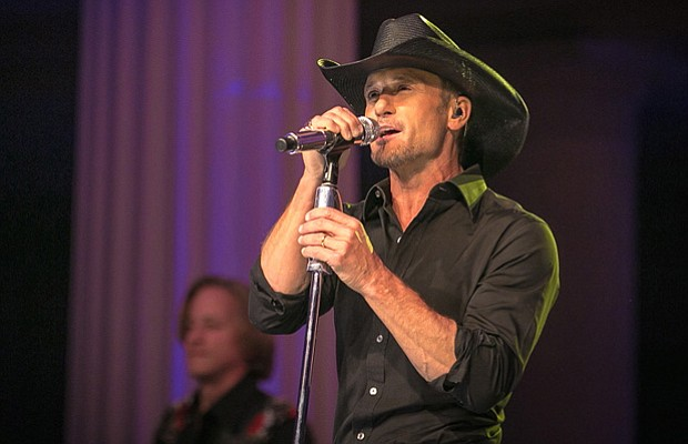 "Country superstar Tim McGraw tears through a dozen songs, including hits ""Sou..."