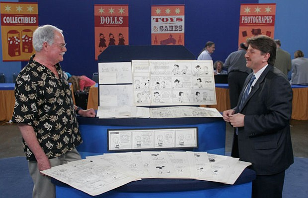 Back in 2006, Philip Weiss (right) appraises Charles Schulz comic strip art, ...
