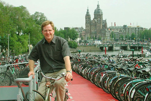 Rick Steves atop the bike garage in Amsterdam. The Basilica of St. Nicholas i...