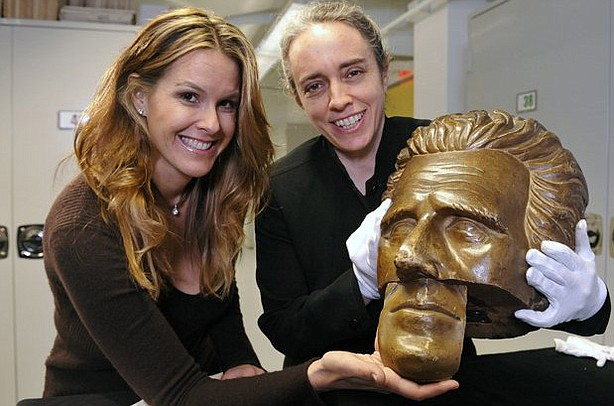 HISTORY DETECTIVES host Elyse Luray reunites the face of an Andrew Jackson statue with its mouth.