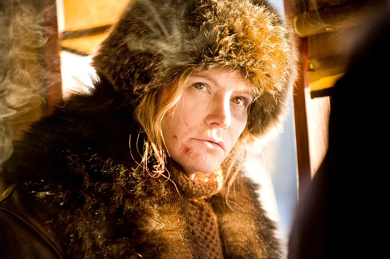 Jennifer Jason Leigh plays Daisy Domergue, a woman wanted for murder and bein...