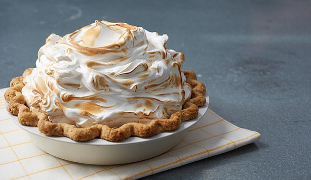 ... show-stopping deep dish pumpkin pie that's billowing with meringue