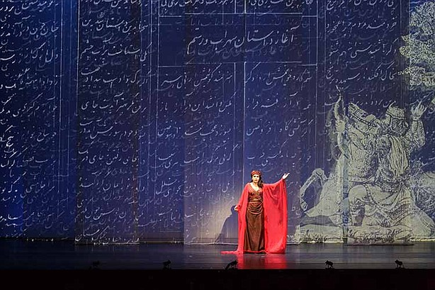 Gordafarid, performing storyteller Ferdowsi in the production of The Scarlet Stone.