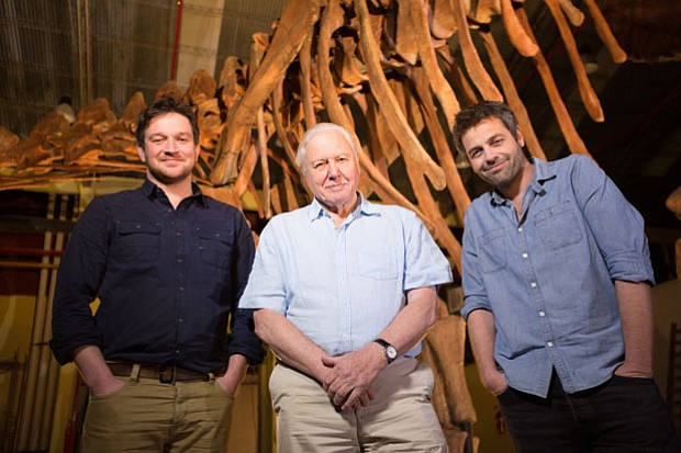Ben Garrod, Sir David Attenborough, and Dr. Diego Pol in front of a new giant...