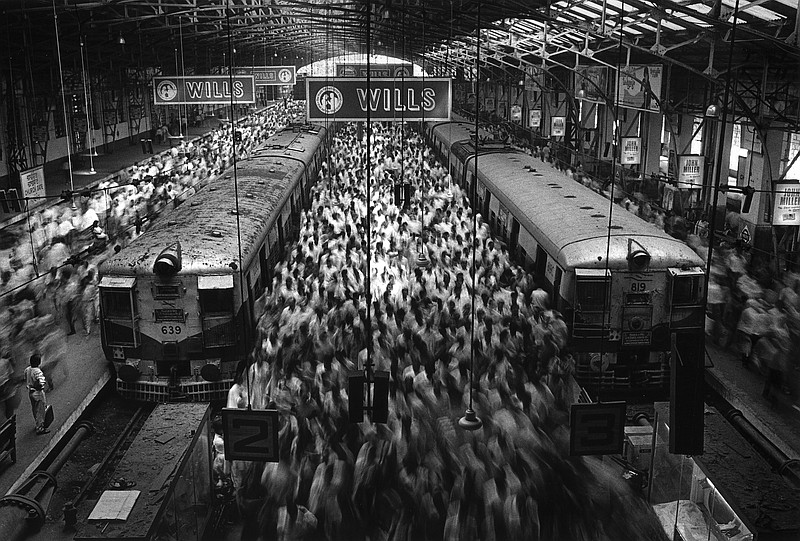 A photograph by photographer Sebastião Salgado of a train station in Bombay, ...