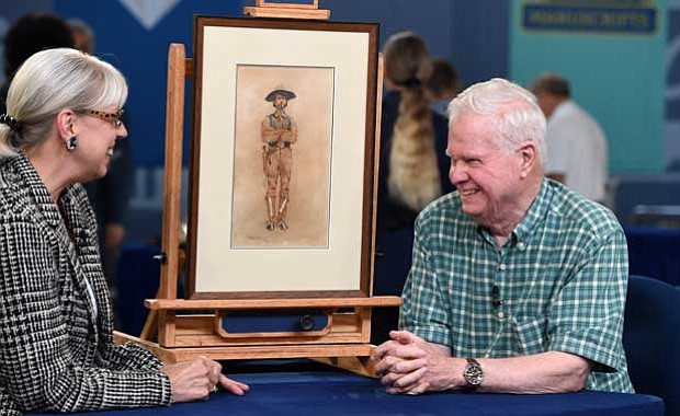 Colleene Fesko (left) appraises an 1890 Frederic Remington watercolor in Char...