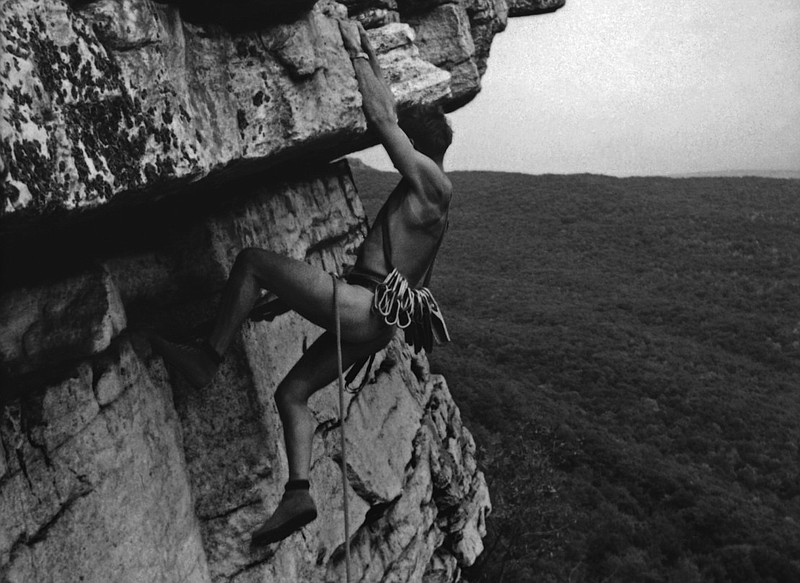 One of the many archive images of rock climbing that make the new documentary...