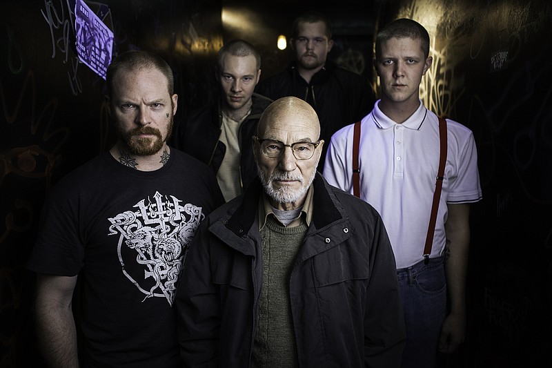 Patrick Stewart (center) is a club owner who also leads a group of white supr...