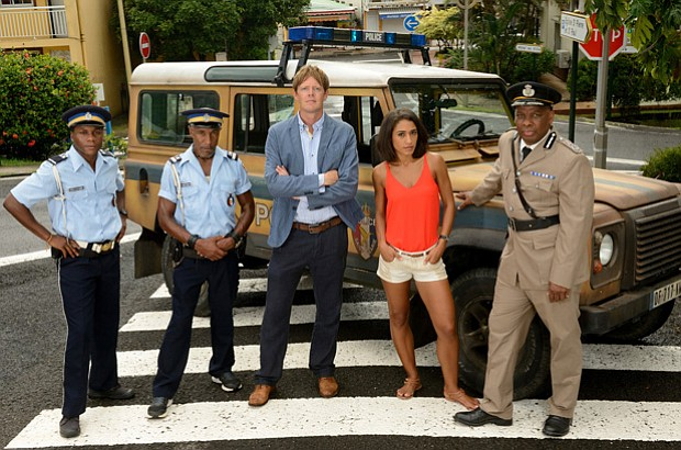 (L-R) The cast of DEATH IN PARADISE: JP (Tobi Bakare), Dwayne Myers (Danny Jo...