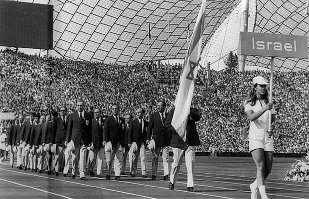 Israeli athletes walk into the stadium with their flag at the Munich Summer O...