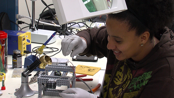 Eugenia Fernandes assembles an underwater robot at MiraCosta College's Techno...