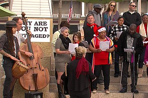As City Leaders Are Sworn In, Homeless Choir Urges End To Ticketing Street Po...