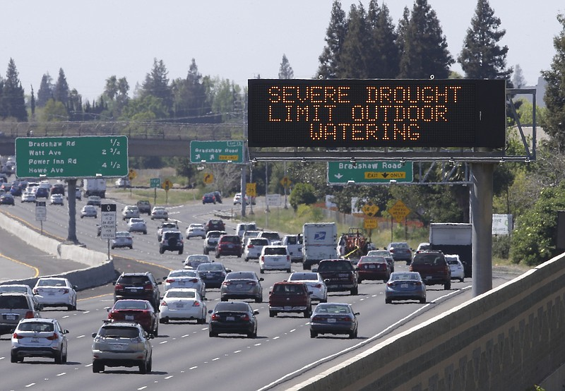 Motorists pass a sign on Highway 50 in Sacramento County's Rancho Cordova rem...
