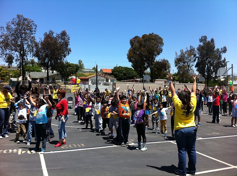 Students at Kellogg Elementary School stretch before the schools first annual...