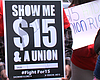 A sign asks for $15 minimum wage outside the Mc...