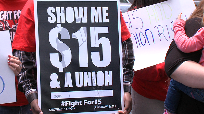 A sign asks for $15 minimum wage outside the McDonald's on Tierrasanta Boulev...