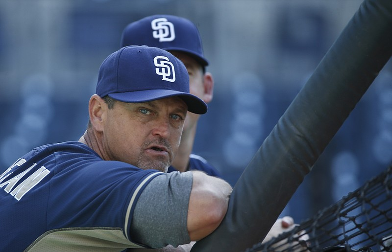 Former San Diego Padres closer Trevor Hoffman leans on the batting cage befor...