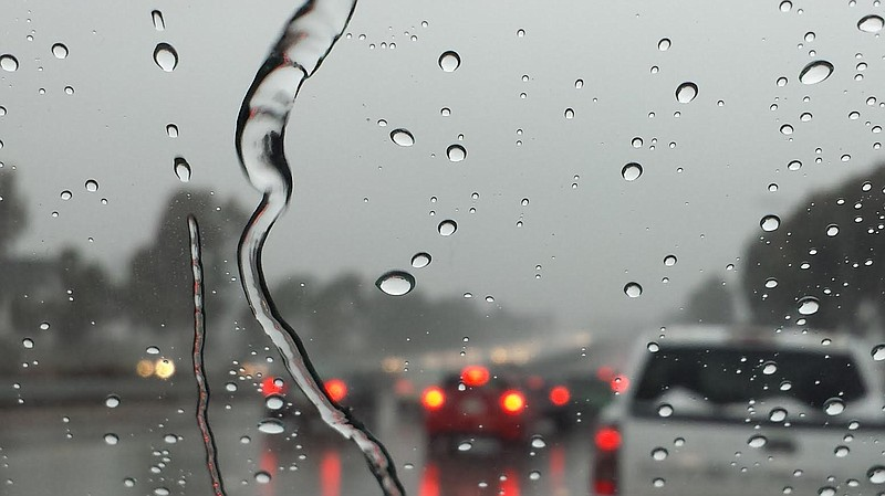 Rain on the windshield of a car stuck in freeway traffic in Spring Valley, Ja...