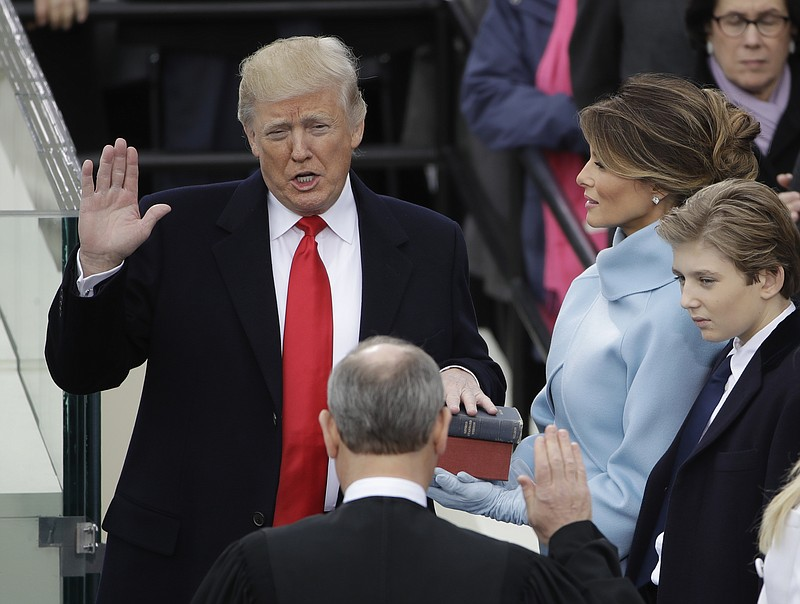 Donald Trump is sworn in as the 45th president of the United States by Chief ...