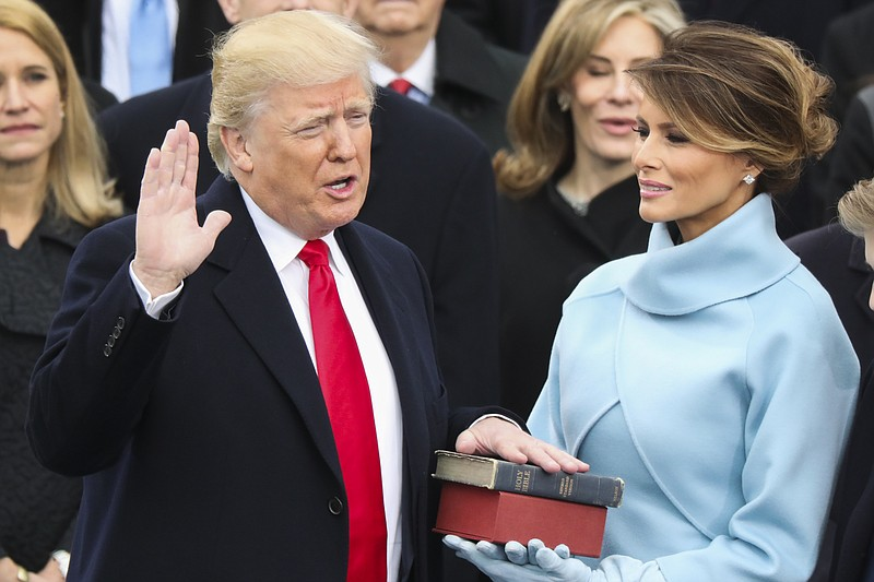 Donald Trump is sworn in as the 45th president of the United States as Melani...