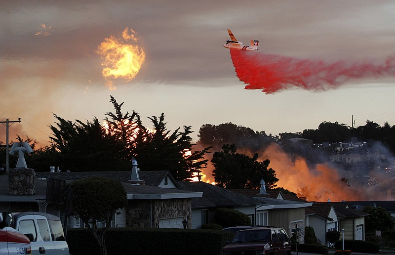In this Sept. 9, 2010, file photo, a massive fire following a pipeline explos...
