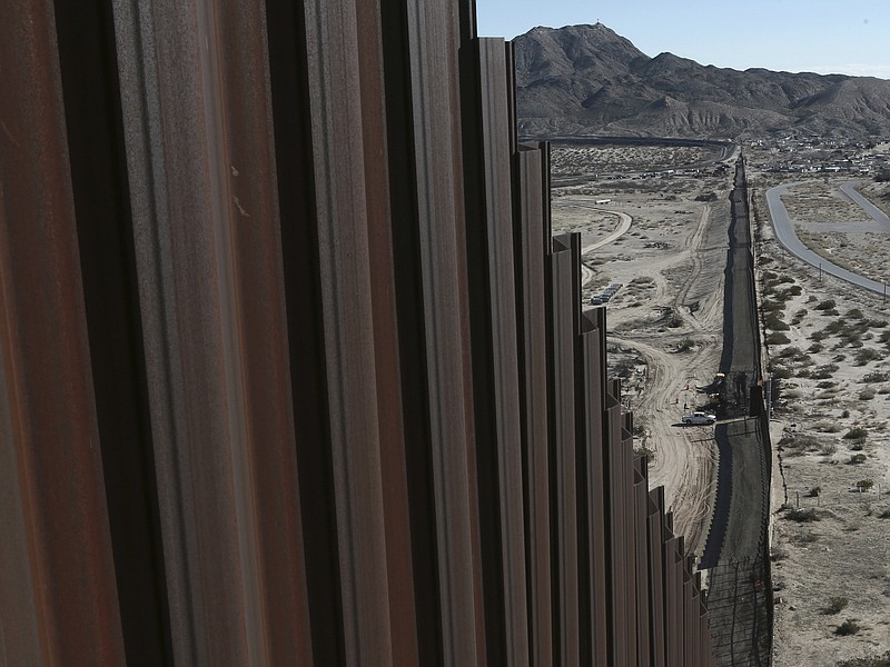 A truck drives near the Mexico-US border fence, on the Mexican side, separati...