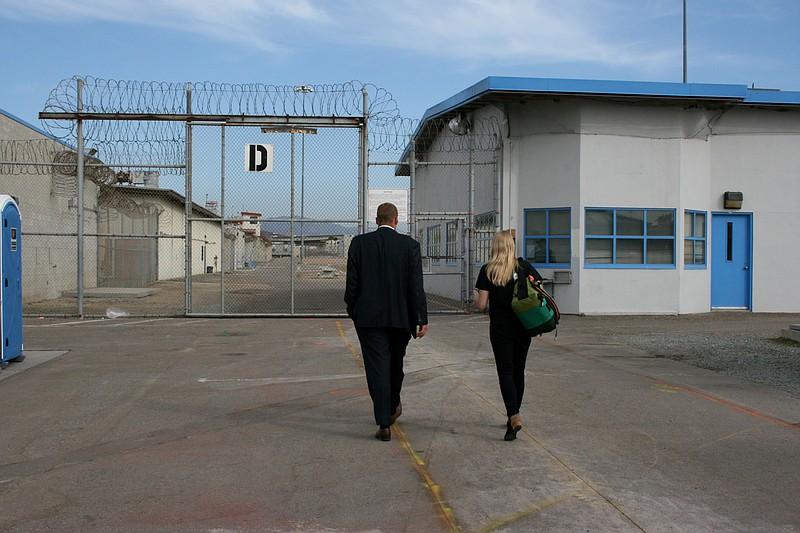 Visitors approaching the exercise yard in D block at Donovan State Prison. Se...