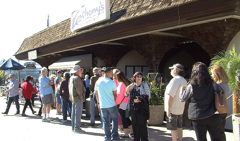 Devoted customers of Anthony's Fish Grotto line up for one last meal before t...