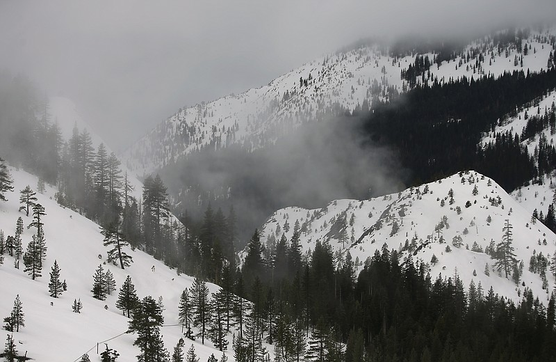 Fog and mist shroud the Sierra Nevada, near Echo Summit, Calif., Thursday, Fe...