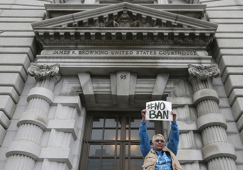 Karen Shore holds up a sign outside of the 9th U.S. Circuit Court of Appeals ...