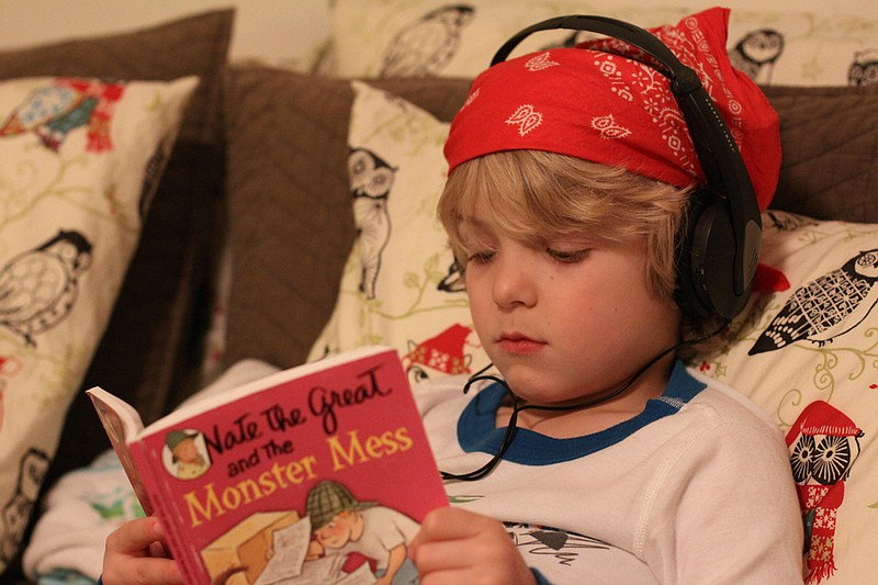 A boy using headphones on Feb. 17, 2010.