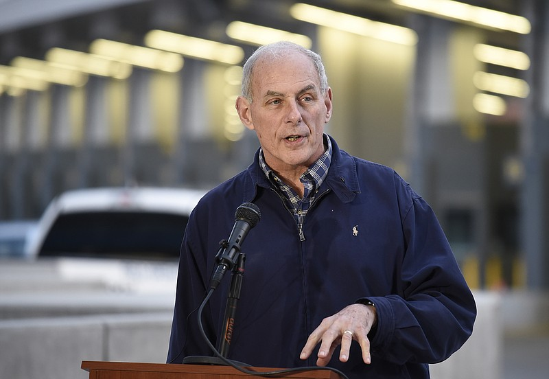 Secretary of Homeland Security John Kelly speaks at a news conference as vehi...