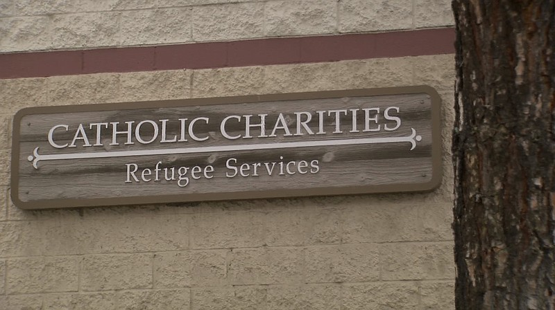 A sign at Catholic Charities in San Diego marks its refugee services building...